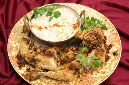 cumin: Homemade fried jeera  cumin  chicken served with cucumber raita and a coriander leaf garnish  The chicken legs are fried in a dry sauce of cumin  jeera , ginger, garlic, cardamom, green chilli, and garam masala for an authentic Indian home meal