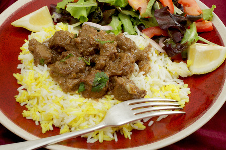 gosh: A plate of  beef rogan josh, served with yellow and white rice and a salad  Rogan josh is usually made with lambequally well with beef  Stock Photo