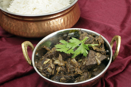 mutton: Mutton liver fried with onion and indian spices to make a traditional Kerala  South India  fry, served with basmati long-grain rice