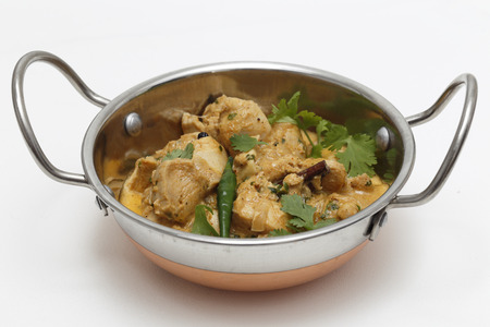 fairly: A kadai serving bowl of balti chicken pasanda curry, garnished with coriander leaves and a green chilli. This curry is made with yoghurt , cream and chopped coriander as well as the usual spices, to give a fairly mild and creamy flavour.