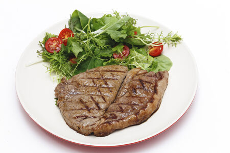homegrown: Low-carb meal of grilled rump steak with a home-grown salad mix and cherry tomatoes Stock Photo