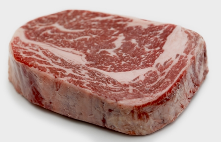 australian beef cow: Ribeye steak from Australian Wagyu cattle. This is fram a Japanese breed of cattle which are famed for heavy marbling and high proportion of unsaturated fats, which make it low in cholesterol. It is a gourmet item and is one of the most expensive kinds of