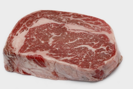 Ribeye steak from Australian Wagyu cattle. This is fram a Japanese breed of cattle which are famed for heavy marbling and high proportion of unsaturated fats, which make it low in cholesterol. It is a gourmet item and is one of the most expensive kinds of photo