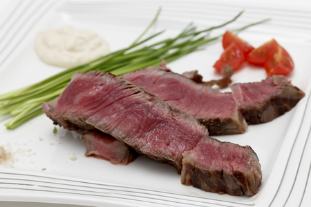 australian beef cow: Grilled wagyu rump steak, served with chives, cherry tomatoes, sea salt, and horseradish source  This is the most expensive gourmet beef in the world so the presentation concentrates on enhancing it rather than drowning the flavours