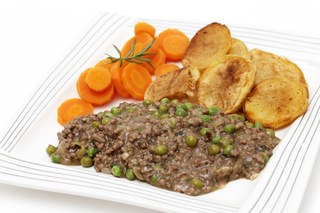 sautee: Minced beef cooked with onion, garlic, peas and herbs, served with sautee potatoes and boiled carrots  This is a simple, slightly old-fashioned British-style meal,