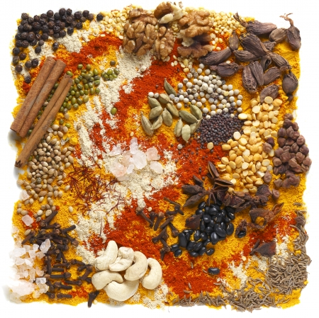 A huge range of indian spices and other ingredients, including black cardamom, green cardamom, kashmiri chilli, black chickpeas, cashew nuts and walnuts, black  soy  beans, cloves, fenugreek powder, mustard seeds, white pepper, split peas, himalayan sald, photo