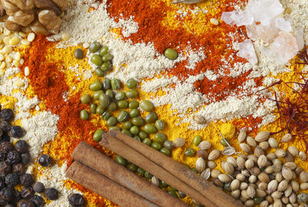 View of an assortment of spices and  ingredients used in indian and other asian cuisines  photo