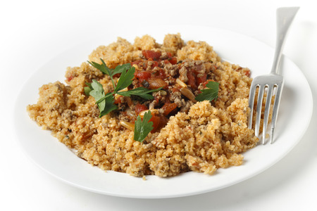 bi: A plate of Lebanese burghul bi banadoura, or cracked wheat with tomatoes  The dish incorporates onion, minced meat and pine nuts, along with the burghul or bulgar wheat