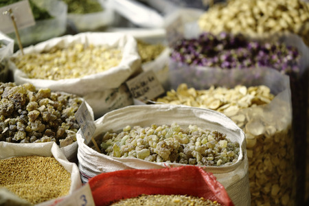 souq: Sacks of Arabian incense with other goods, including rose leaves and garlic, in the spice section of Souq Waqif in Doha, Qatar, Arabia