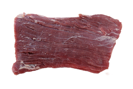 A piece of raw flank steak, also known in the US as London broil, isolated on white