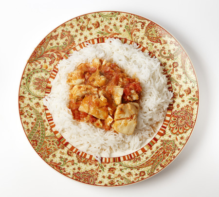 basmati: Basic fish curry, in a spicy tomato and coconut milk sauce, served on a bed of basmati rice