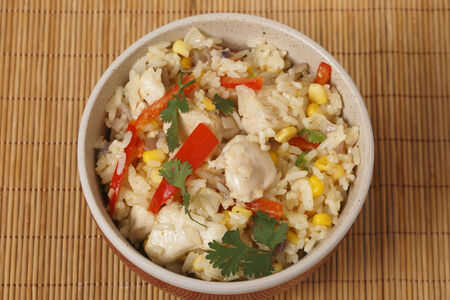 sweetcorn: Chicken fried rice, containing capsicum, rice, garlic, egg, in a bowl from above