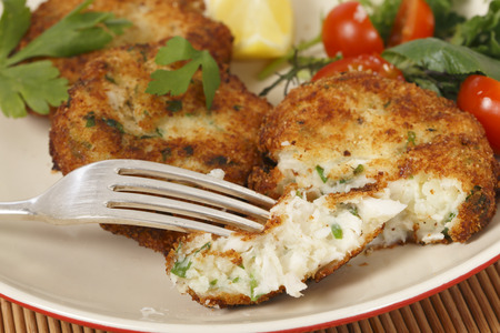 Easy to make fishcakes, with steamed fish crumbled into mashed potato and parsley mix Stock Photo