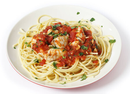 flaked: Spaghetti allarrabbiata with fish, garnished with parsley. The sauce is made from tomato, garlic, olive oil and flaked chillis.