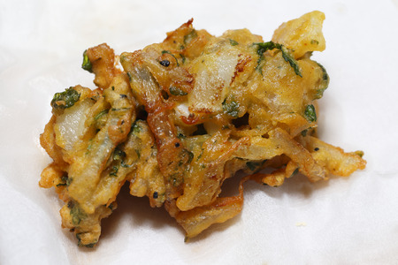 chickpea: An onion bhaji, straight from the pan, draining on a sheet of kitchen paper