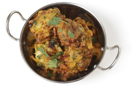 onion bhaji: Homemade onion bhaji Indian appetisers in a kadai serving bowl, seen from above
