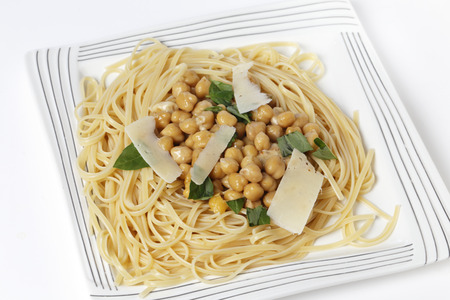 garbanzo bean: Bavette pasta, almost identical to linguine, served with a chickpea, garlic, chili and parmesan sauce, and garnished with torn basil leaves Stock Photo
