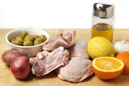 Ingredients for a Mediterranean style chicken dish with citrus fruits and green olives. photo