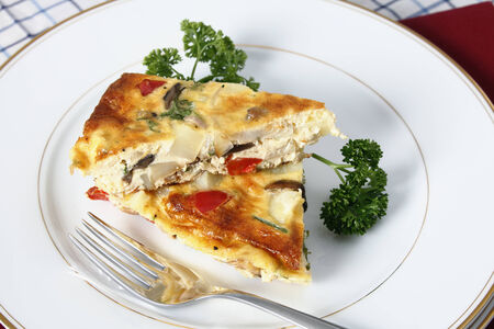 omelet: Slices of Spanish omelette on a plate with a fork. Stock Photo