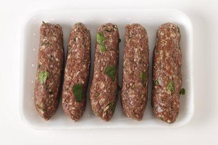 seekh: Supermarket tray of raw Lebanese or Arab lamb kofta