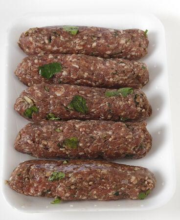 seekh: Supermarket tray of raw Lebanese or Arab lamb kofta, vertical