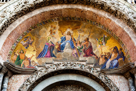 interceding: Mosaic at the entrace to San Marco Basilica in Venice, depicting the Last Judgement, with Christ at the centre and the Virgin Mary interceding for those on trial.