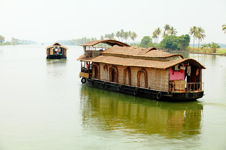 alappuzha: Houseboats, used for tourism, on the backwaters of Kerala, South India Stock Photo