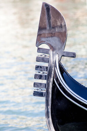 prow: The distinctive prow of a Venetian gondola on the Grand Canal in Venice, Italy.