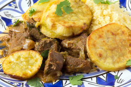 moroccan cuisine: Moroccan sweet potato and beef tagine closeup on a plate. A traditional dish from Fez