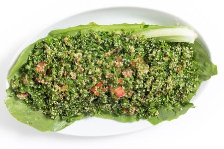 Homemade Lebanese-style tabouii, made with raw parsley, mint, cucumber, tomato, burghal aka bulgar wheat, lemon juice, olive oil, salt and spices. photo