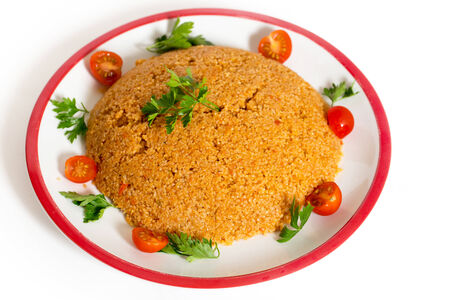 bulgur: Turkish bulgar pilaf made with bulgur, or burghul, wheat, onion, capsicum, and tomato, This is a staple of Turkish cuisine.