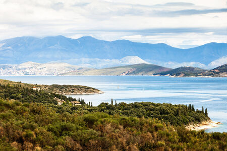 kerkyra: A view of the coastline of north-east Corfu, Greece, with the Albanian mountains across the strait.