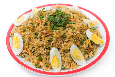 haddock: English-style breakfast kedgeree, a meal of rice, smoked fish, eggs and vegetables. Stock Photo