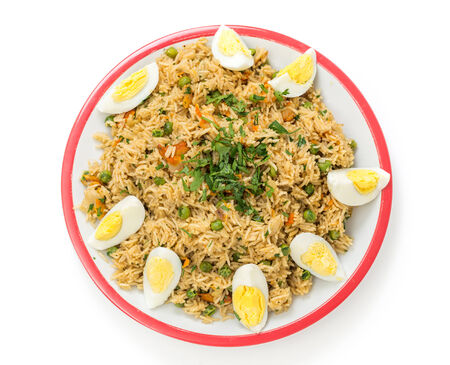 impure: English-style breakfast kedgeree, a meal of rice, smoked fish, eggs and vegetables. Stock Photo