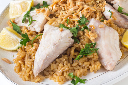 slivers: Lebaneses-style fried fish served with caramelised onion flavoured rice and roasted almond slivers.