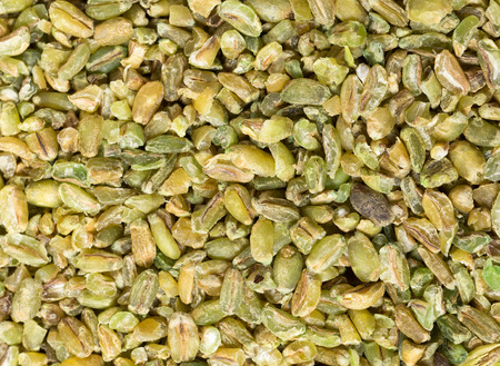 potentially: Grains of uncooked freekeh, an old Middle Eastern cereal made by fire-roasting immature wheat grains. The cereal has a very low glycemic index and is high in protein, fibre and minerals, making it a paleo superfood and potentially a useful ingredient in