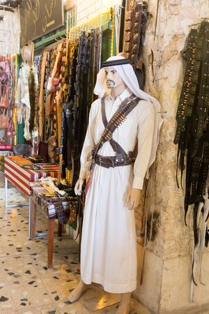 bedoin: DOHA, QATAR - MARCH 8, 2015: Mannequin of a Qatari bedoin warrior outside a souvenir shop in Souq Waqif, Doha.