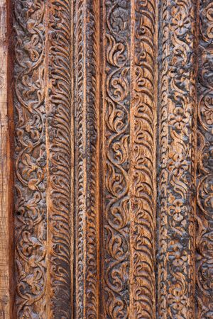 souq: DOHA, QATAR - MARCH 8, 2015: Detail of traditional Arab carving on an antique door frame in Souq Waqif shopping area, a popular tourist attraction.