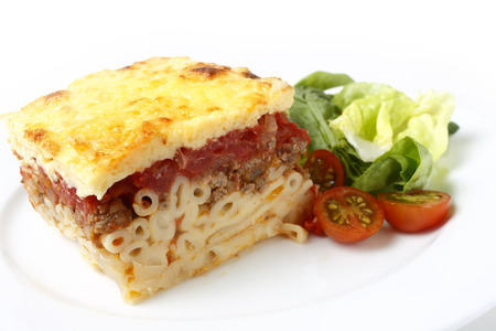 greek: Traditional Greek pastitsio with a salad of tomatoes, lettuce and spinach