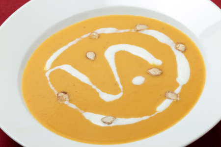 butternut squash: Closeup view of a plate of traditional French butternut squash soup in a bowl