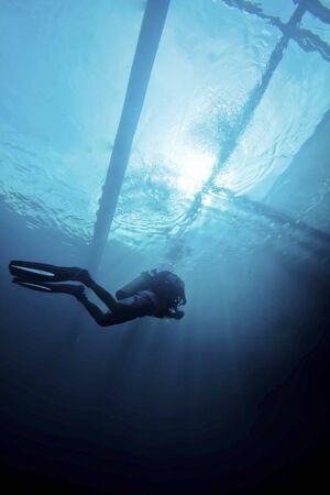 diver silhouette below a banka boat Stock Photo - 15803082