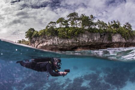 divers: diver reviewing a healthy reef Stock Photo