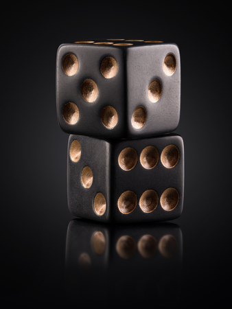 two black dice on a black background