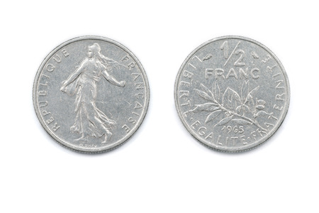 minted: A French Half-Franc coin minted in 1965 and featuring seed sowing on the face and an olive branch on the reverse. Stock Photo