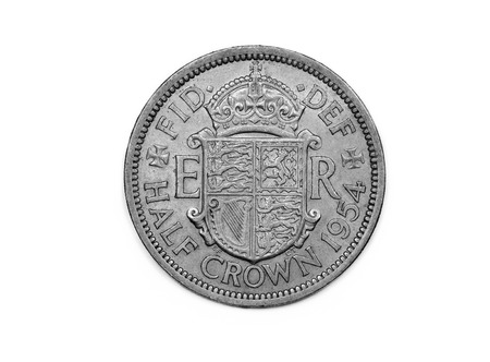 minted: A half Crown coin from the U.K. minted in 1954 featuring the shield of the Royal Standard on the reverse side