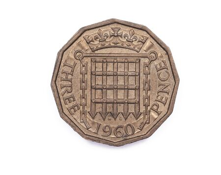 portcullis: A Threepenny coin reverse side from the U.K. minted in 1960 and featuring a portcullis and a crown.
