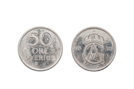 minted: A fifty Ore coin from Sweden minted in 1973 and isolated on a white background.