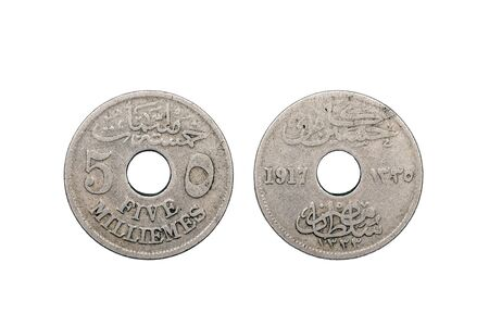 minted: A five Milliemes coin from Egypt minted in 1917 and featuring a hole through the middle of the coin set on a white background.