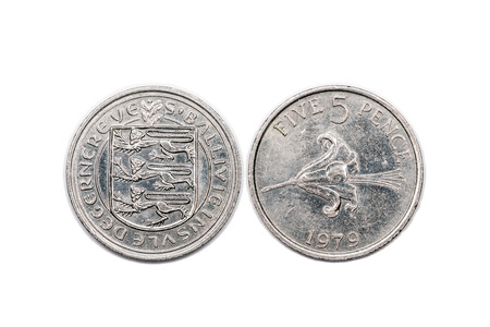 bailiwick: A five pence coin from the Bailiwick of Guernsey and minted 1979. The coin is isolated onto a white background