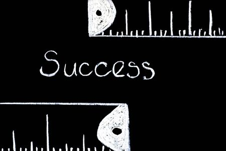 literal: Measuring Success - literal representation using Chalkboard and white chalk.